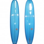 Lightweight Longboard Log #8701. Single fin with blue resin tints.