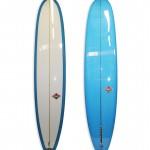 Lightweight Model Longboard #8592. Single fin log with 50/50 rails, blue resing tints on bottom of board.